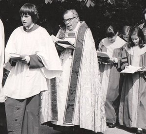 Rev. Herbert Walter Langford with altar boy Graham Leach walking up the footpath of All Saints' Church, Winthorpe - Rogation Sunday 15th May 1977.