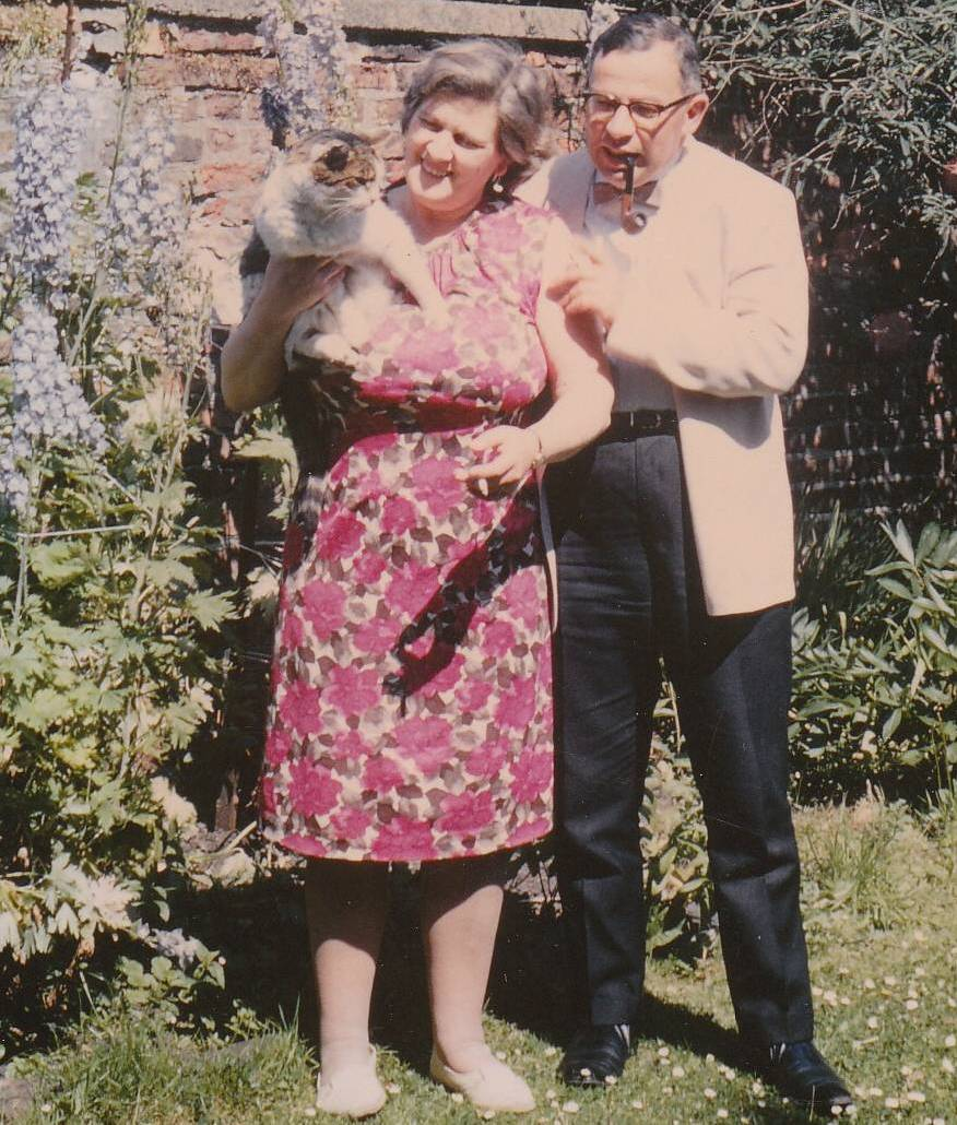 Rev. Herbert Langford with his wife Molly and their pet cat in their Durham garden - 1967.