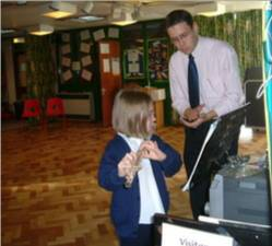 A pupil having flute lessons from Mr. Reid at Winthorpe County Primary School - 2005.